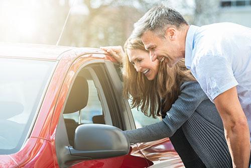 Couple Looking at Car