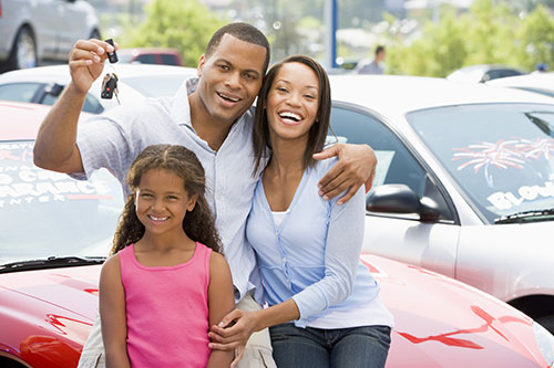 Family with keys to car