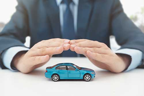 Car covered by hands